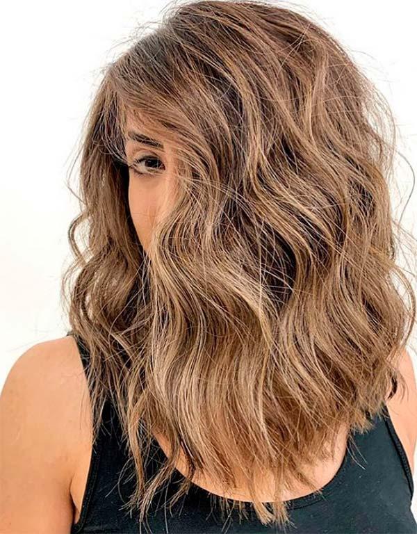 Современные женские стрижки на средние волосы